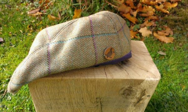 Tweed flat cap with purple and teal check