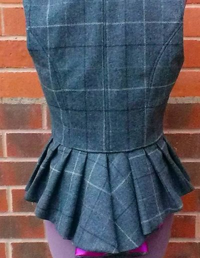 Ladies tweed waistcoat with waterfall peplum back view